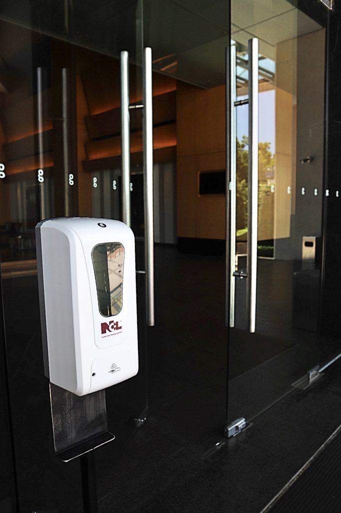 Hand sanitizer at the main entrance of g hotel.