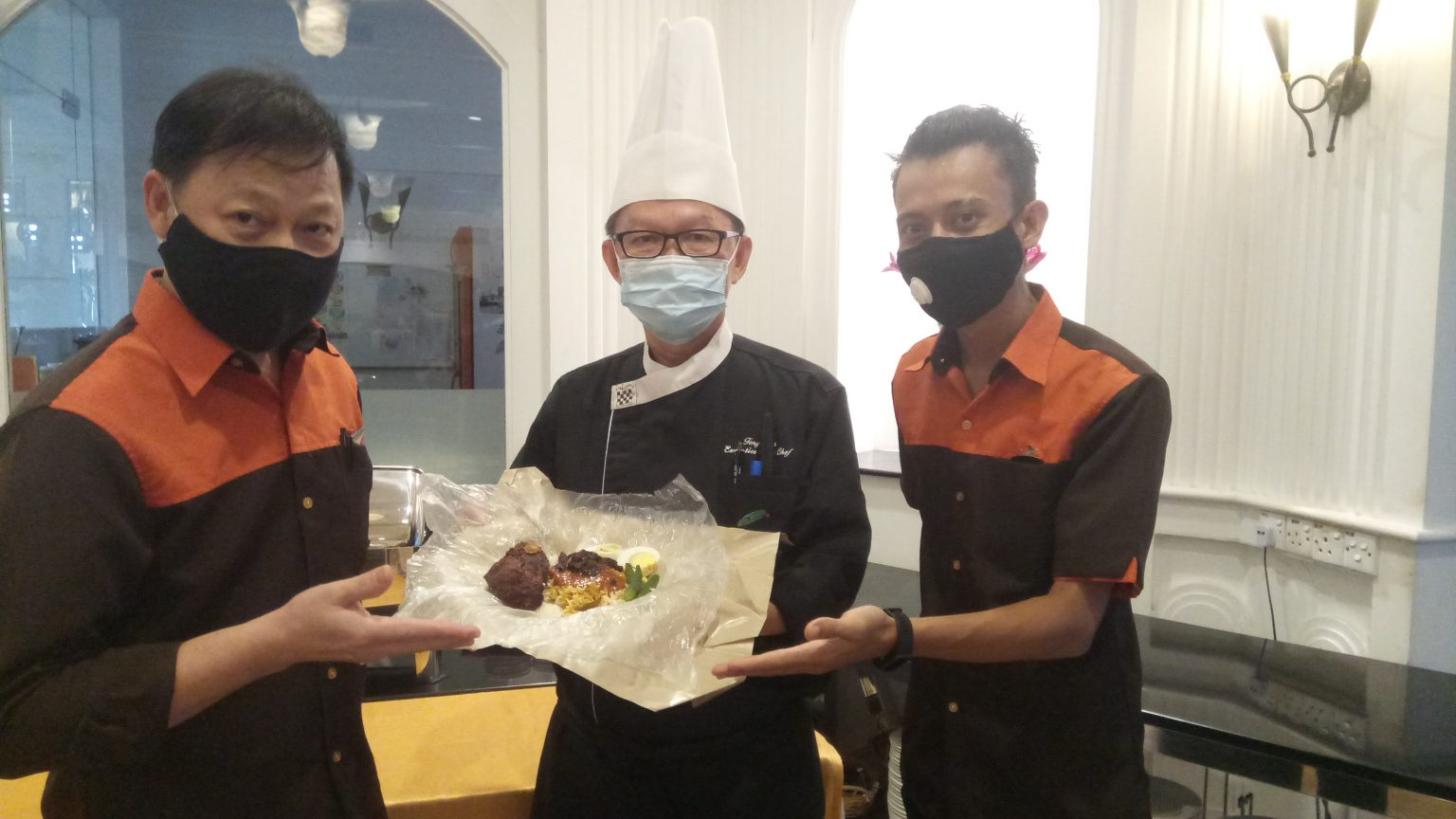 Chef Tony Tan and team with nasi bantal dish.
