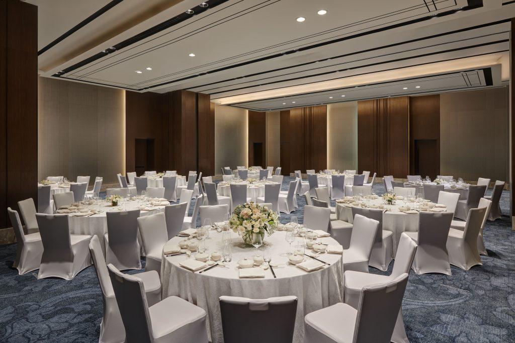 Ballroom set up for a banquet.