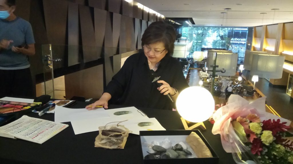 Sharon doing a demonstration of her colour pencil works.