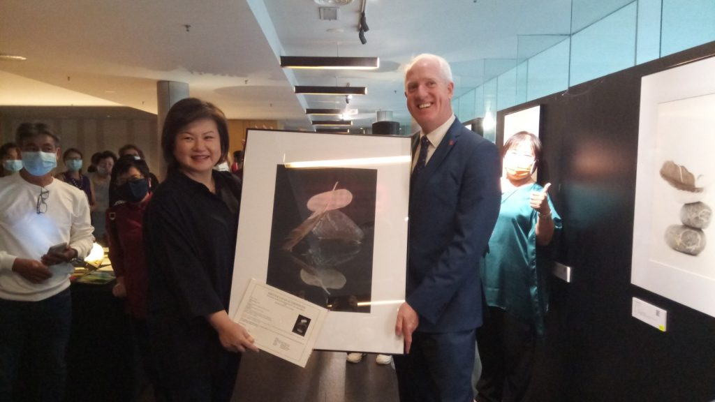 Sharon presenting one of her works to Michael Hanratty.